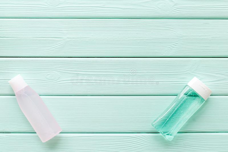 Mycelial water, lotion for skin care on mint green wooden background flat lay space for text royalty free stock images