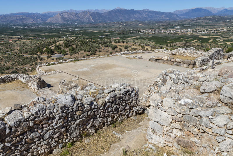 Mycenae, view of the Palace building. And the view of the valley below. Mycenae is an archaeological site in Greece royalty free stock images