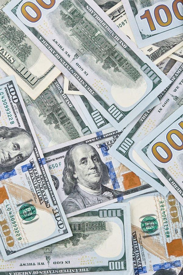 Mycket amerikanska dollarsedlar 100 bockar arkivbild