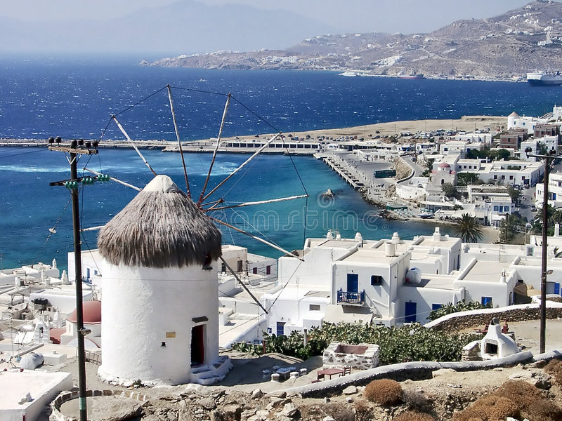 Mykonos. Typical view of Mykonos and one of his windmills, Greece