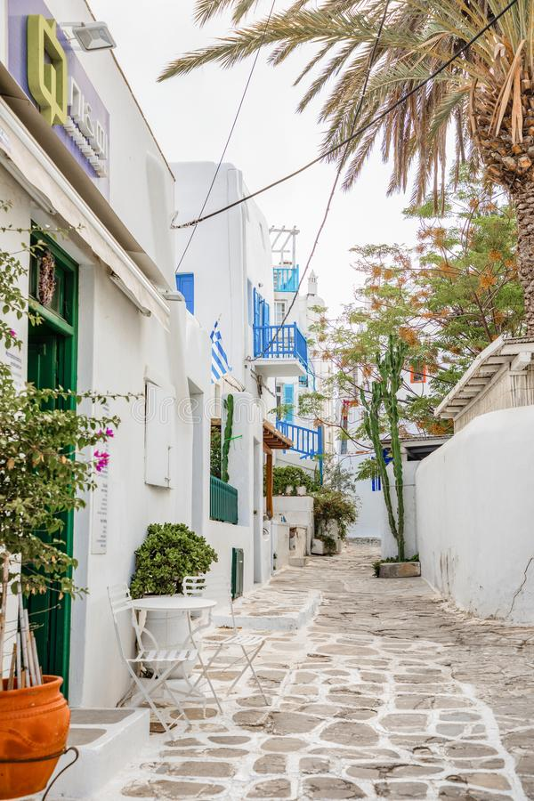 Mykonos, Greece - 17.10.2018: Traditional houses with blue doors and windows in the narrow streets of greek village in royalty free stock images