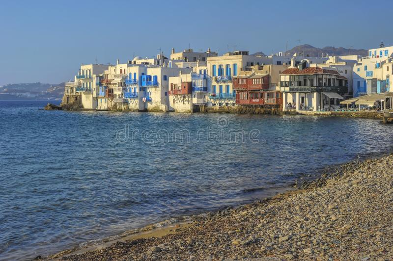 Mykonos Greece View of the bay of Mykonos center, with its typical white houses with blue windows, in ancient Greek style. Myconos Greece View of the bay of stock photo