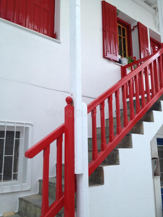 Mykonos - White House with Red stairs and shutters stock photo