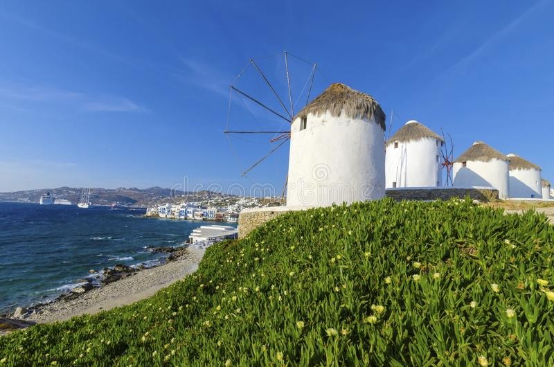 Mykonos windmills, Chora, Greece. Four windmills in Chora, Mykonos, Greece. Very traditional greek whitewashed architecture, a popular landmark and tourist royalty free stock images