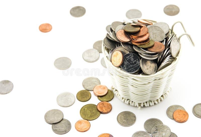Mynt belägger med metall på vit bakgrund arkivbilder