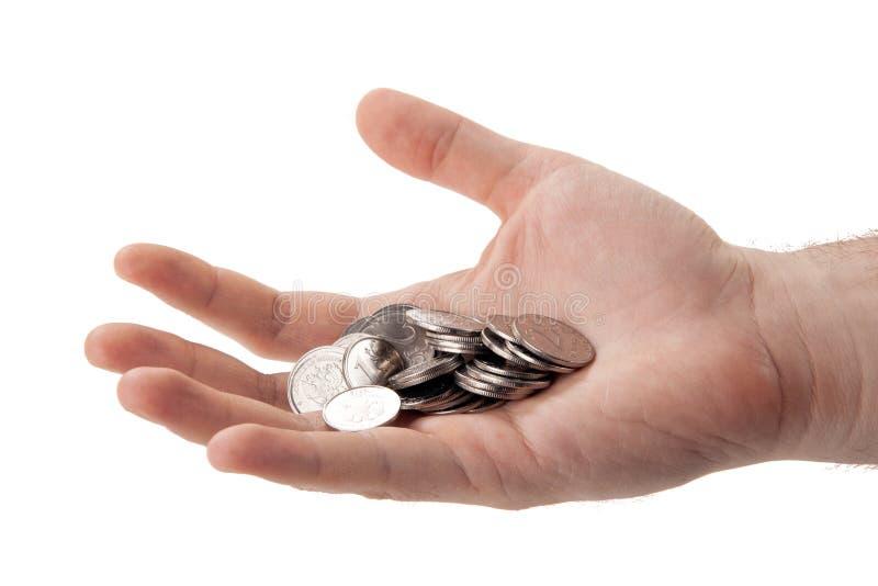 Mynt för rysk rubel i gömma i handflatan av en person arkivfoto