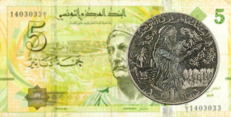 1 mynt för tunisian dinar mot sedel för tunisian dinar 5 royaltyfri foto