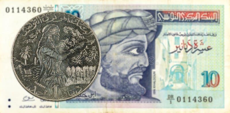 1 mynt för tunisian dinar mot sedel för tunisian dinar 10 fotografering för bildbyråer
