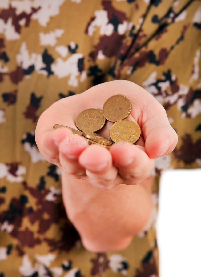 Mynt i handen arkivfoto