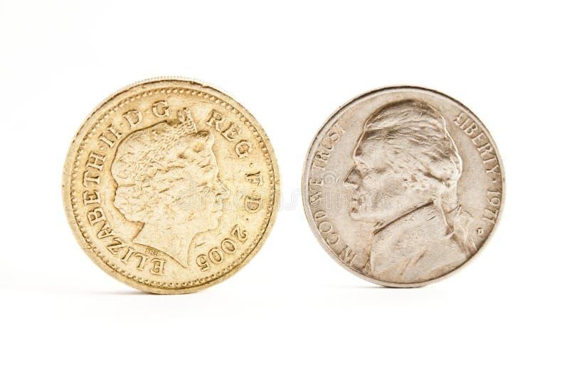 Mynt och pund arkivfoto