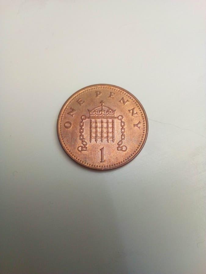 mynt 1p royaltyfria bilder