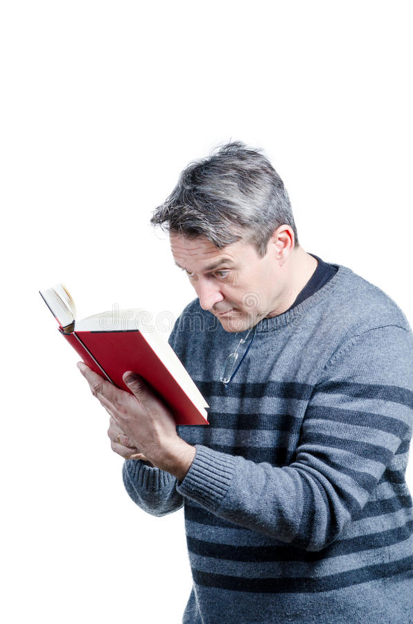 Myopia. Guy having to hold a book very close, a myopia concept royalty free stock photography