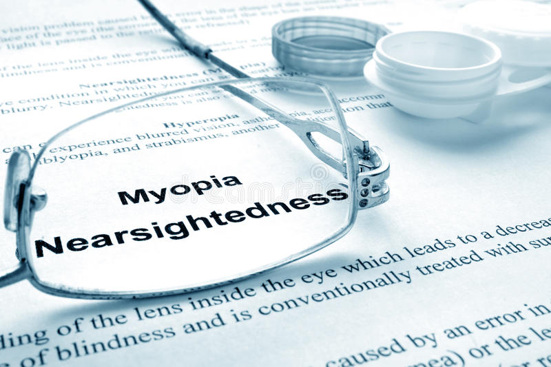 Myopia (nearsightedness). Paper with words myopia (nearsightedness), glases and container for lenses. Eye disorders royalty free stock photo