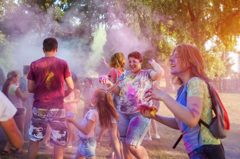 Myrhorod, Ukraine - June 16, 2019: Group of a young people throwing paints on indian Holi festival of colors stock photos