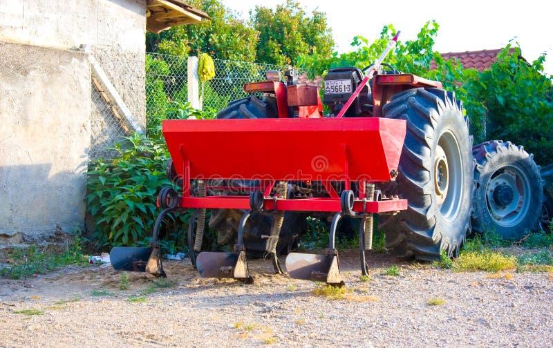 MYRTIA, GREECE - JUNE 16, 2014: Red tractor in yard. MYRTIA, GREECE - JUNE 16, 2014: Tractor in yard stock photos