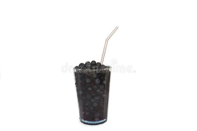 Myrtilles dans un verre de cocktail image stock