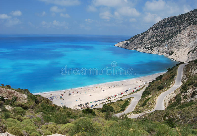 Myrtos. Beach is situated in the region of Pylaros, in the north-west of Kefalonia, Greece. The beach is situated between the feet of two mountains, Agia Dynati stock images