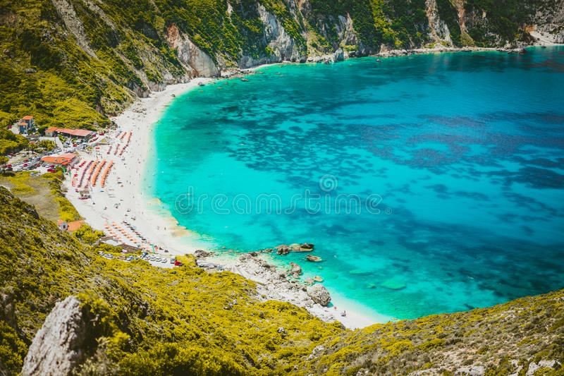 Myrtos beach with azure blue sea water in the bay. Favorite tourist visiting destination place at summer on Kefalonia stock images