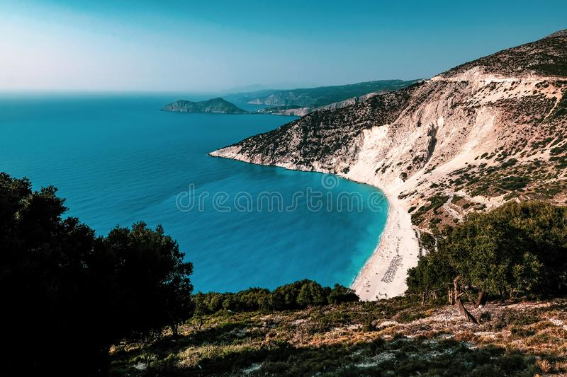 Myrtos Beach and the Mediterranean in Kefalonia, Greece. The beautiful azure sea and white sands of Myrtos Beach in Kefalonia, Greece royalty free stock image