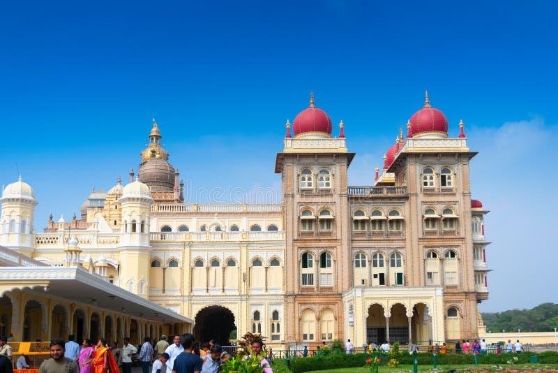 Mysore Palace, Karnataka, India. Mysore, Karnataka, India - November 25th,2018 : A group of tourists visiting Mysore Palace, a historical palace and a royal stock photography
