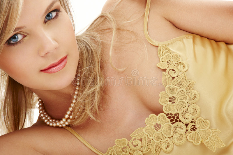 Mysterious blue-eyed blond in pearls #2. Portrait of mysterious blue-eyed blond in pearls royalty free stock photo