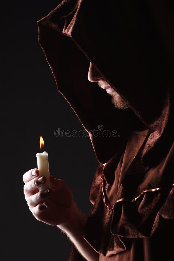 Mysterious Catholic monk. Studio shot royalty free stock photography