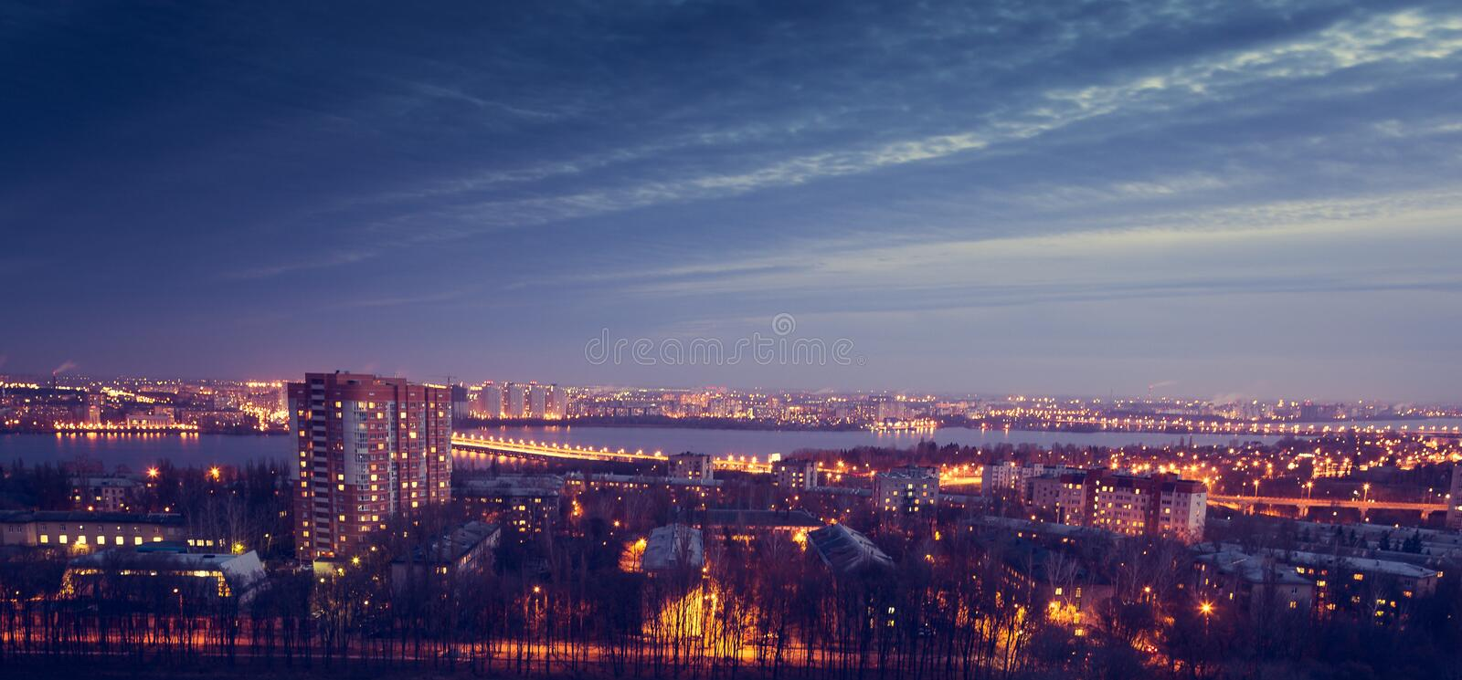 Mysterious dramatic night cityscape view of Voronezh city after sunset. Houses royalty free stock images