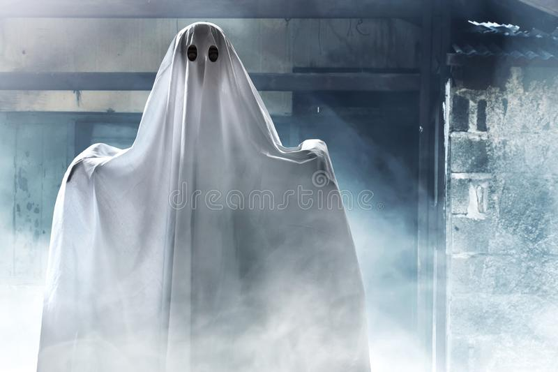 Mysterious ghost on haunted house stock images