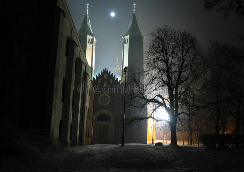 Mysterious gothic cathedral in Plock Poland at night by the moonlight. Cathedral of the Blessed Virgin Mary of Masovia, in Plock. Mysterious gothic cathedral in stock images