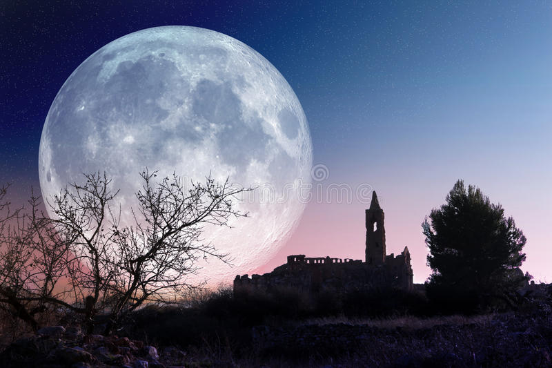 Mysterious landscape. With full moon and church stock images