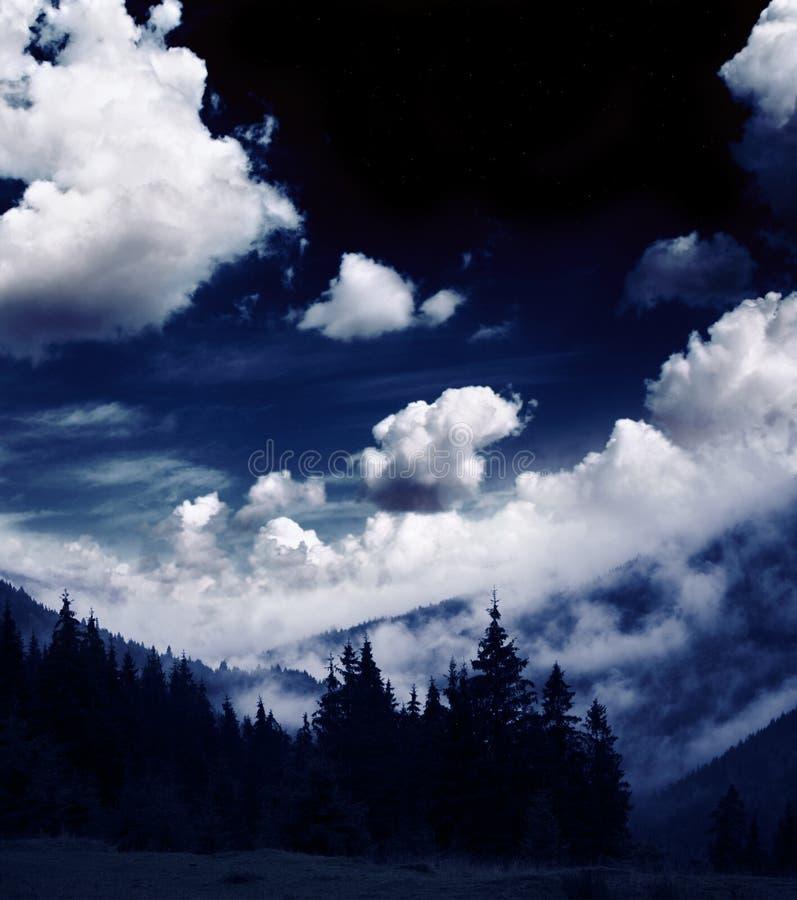 Mysterious landscape of foggy mountain stock photos