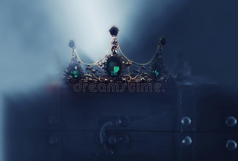 Mysterious and magical photo of of beautiful queen/king crown over gothic dark background. Medieval period concept royalty free stock images