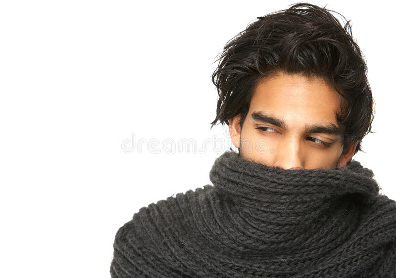 Mysterious man with face covered by wool scarf royalty free stock images