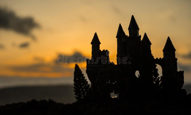 Mysterious medieval castle at sunset. Abandoned gothic style old castle at the evening. stock image