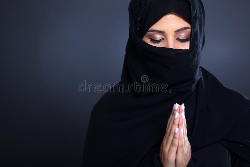 Middle eastern praying royalty free stock photo