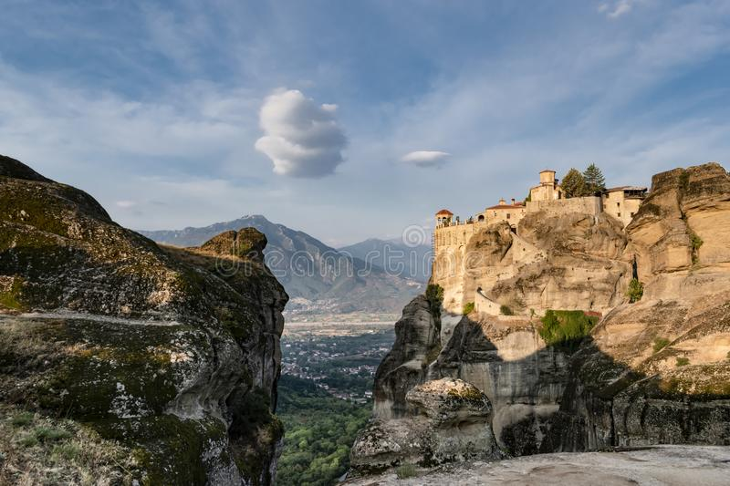 Mysterious monasteries hanging over the rocks of Meteora. Beautiful view of the Varlaam Monastery, located on the edge of a high stock photos