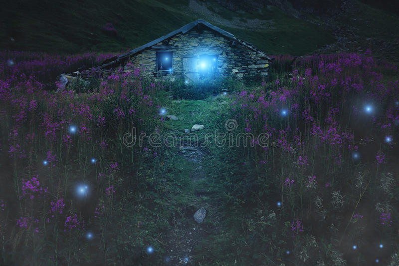 Download Mysterious Mountain Cabin With Magical Lights Stock Photo - Image of will, fairy: 58396810