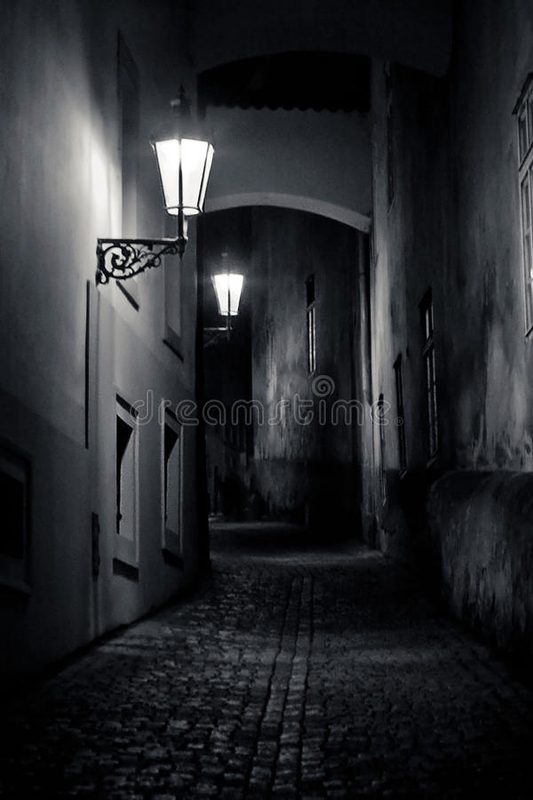 Mysterious narrow alley with lanterns stock photography