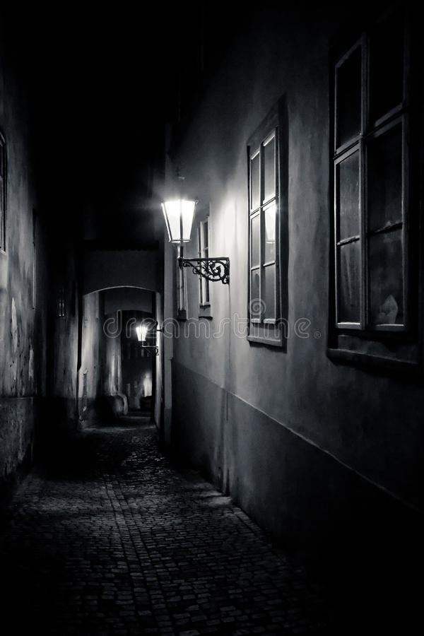 Mysterious narrow alley with lanterns. In Prague at night stock photos