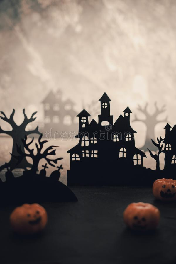 Mysterious night landscape with houses silhouettes and graveyard Template for design with space for  text stock photo