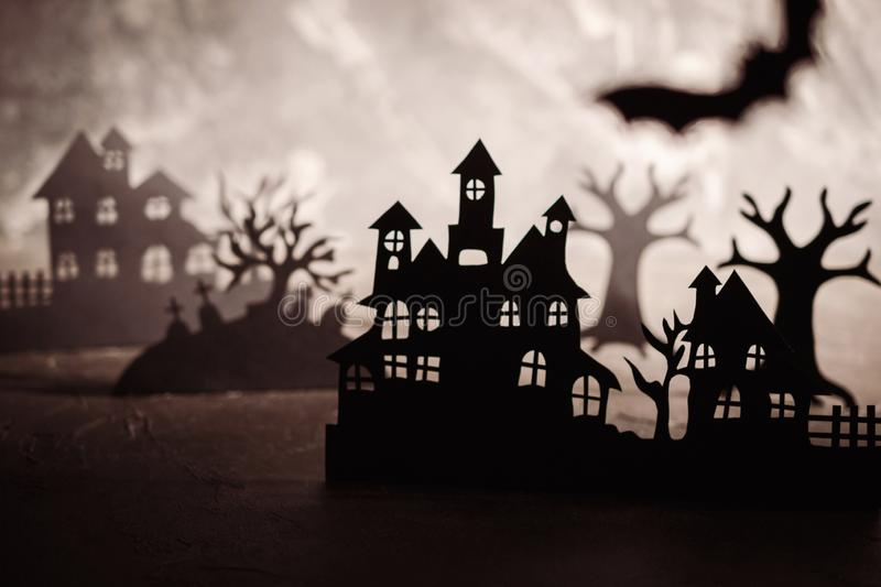Mysterious night landscape with houses silhouettes and graveyard Template for design with space for  text royalty free stock photography