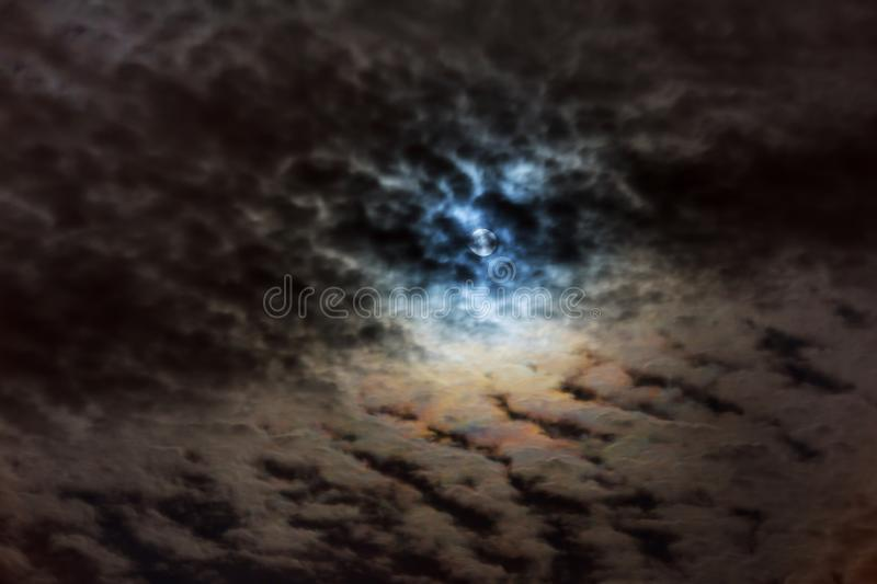 Mysterious night sky with full moon. Dramatic clouds in the moonlight from full moon. stock photos