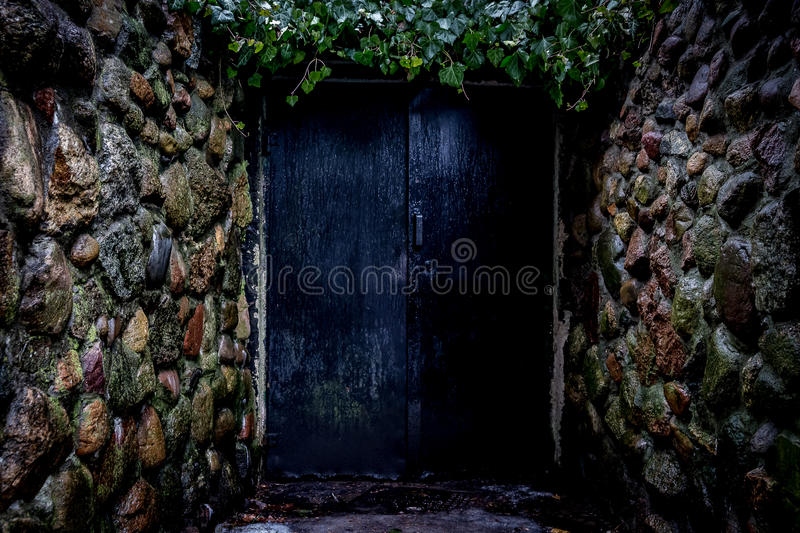Mysterious old door. Mysterious door to another mystery stock photos