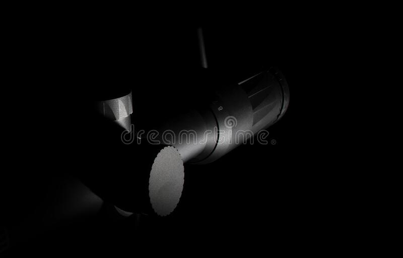 Mysterious rifle scope on a dark background stock photos