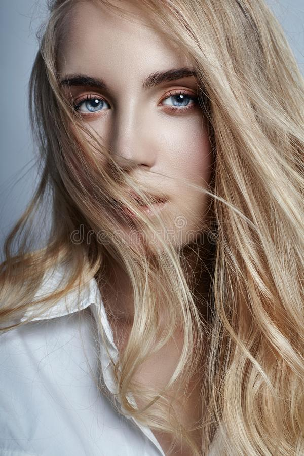 Mysterious and romantic with long blonde hair waving in the wind royalty free stock photo