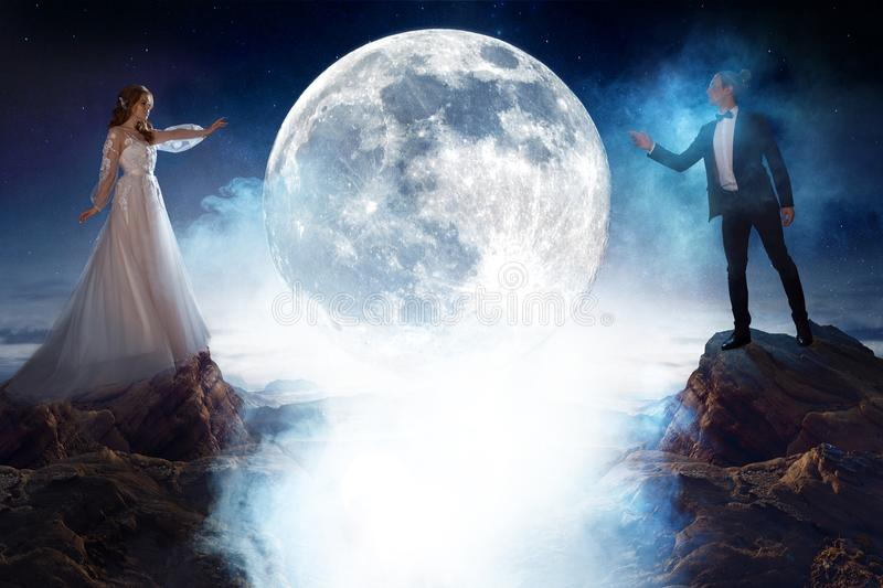 Mysterious and romantic meeting, bride and groom under the moon. Man and woman pulling each other`s hands. Mixed media royalty free stock image