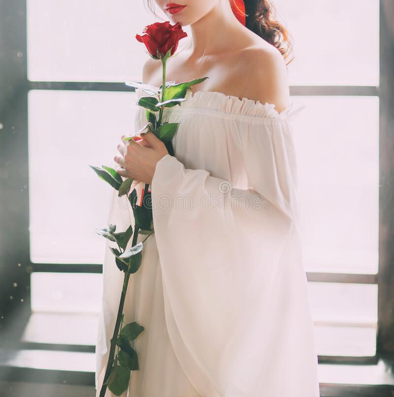 Free Mysterious Silhouette Young Princess. White Vintage Dress. Red Rose In Hands Stock Image - 177207711