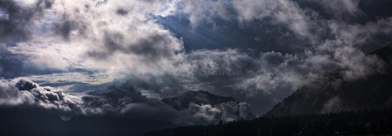 The mysterious sky of Altai. The mysterious and unusually beautiful sky above the Altai mountains, the Northern coast of Teletskoye Lake royalty free stock photos