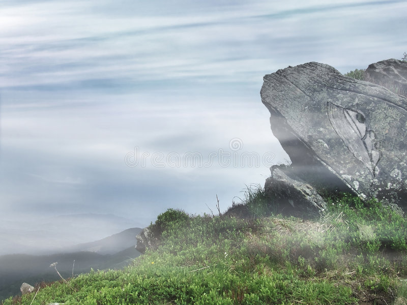 Mysterious stone. Strange stone surrounded by mist stands on the mountain top royalty free stock images