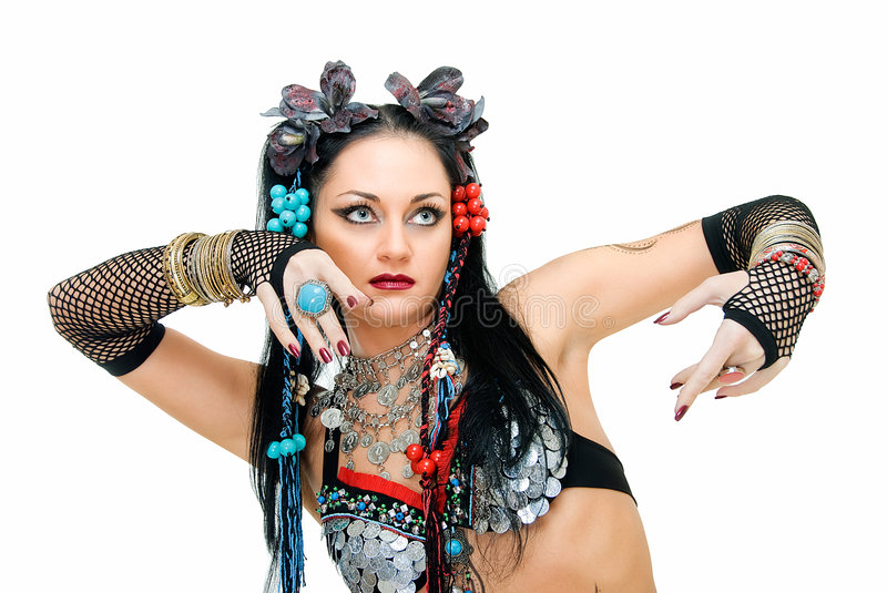 Mysterious tribal. Alluring young tribal dancer in pose on white royalty free stock photos